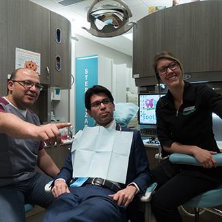 Dr. El Gamal showing patient xrays