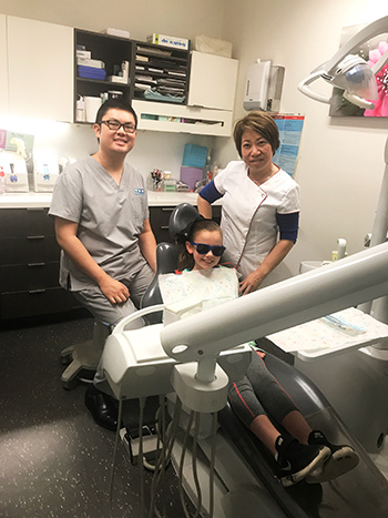 Dr Wong with patient and dental nurse