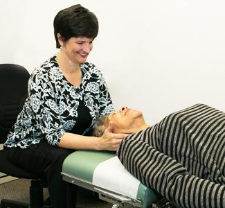 Dr. Sampair adjusting neck
