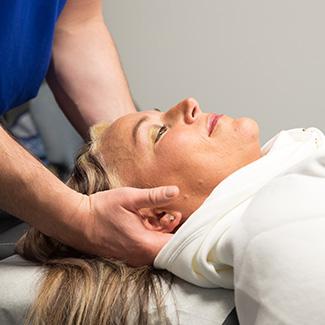 Hands on neck adjusting