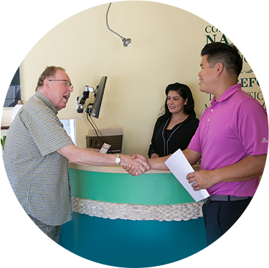 Dr. Brian Shui shaking hands with patient at front desk