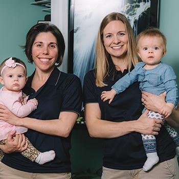 Staff holding children