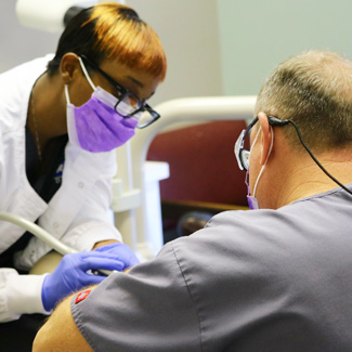 Dental assistant and dentist treating a patient
