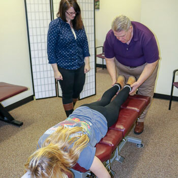 Dr. Rick Nyhan adjusting a patient
