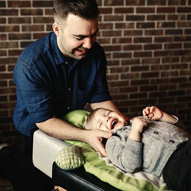 Dr. Alex adjusting child