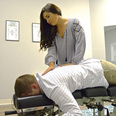 Dr. Amanda adjusting patient