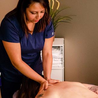 Massage Therapist performing massage