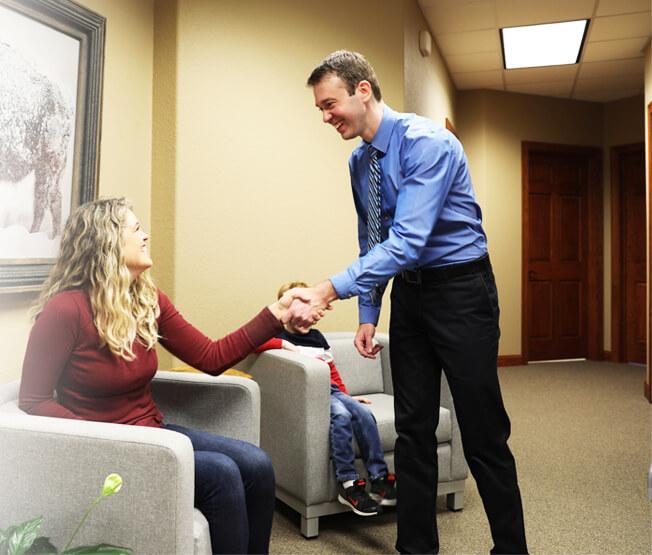 Dr. Konstant shaking patient's hand