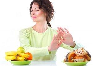 Woman saying no to sweet treats