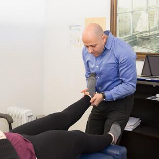 Adjusting patient's foot