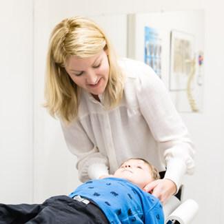 Dr. Allison giving child adjustment