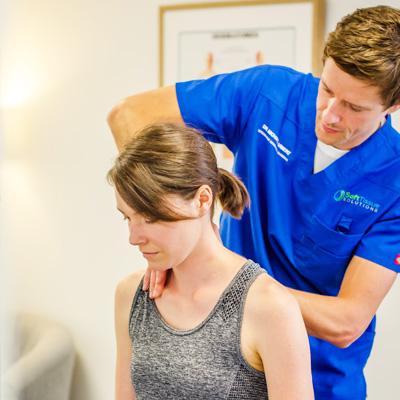 Dr Vibert adjusting a patient