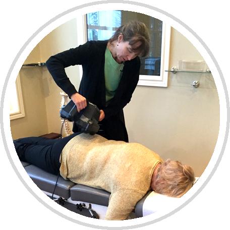 Dr. Leanne adjusting patient