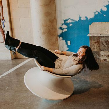 Girl balancing on chari