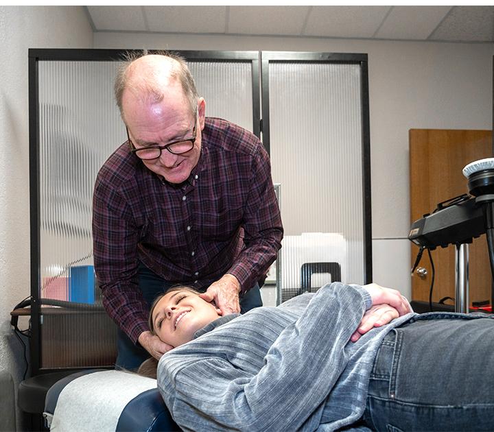 Dr. Peter using adjusting tool
