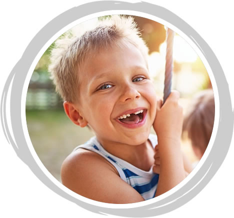 Young boy with missing tooth laughing