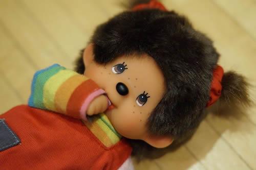 Thumb sucking doll