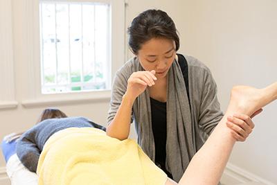 Yuli Rai with massage client