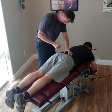 Dr. Hale adjusting patient