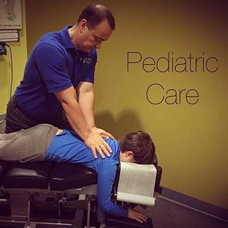 Dr. Watts adjusting child