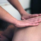 Massage therapist applying massage