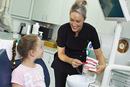 Jackie Edmunds with a child patient