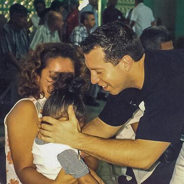 Dr. Kleinburg adjusting a little girl