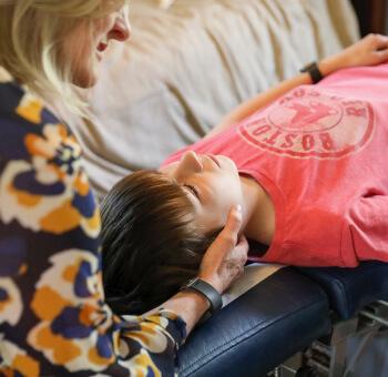 Dr. Cindy adjusting boy