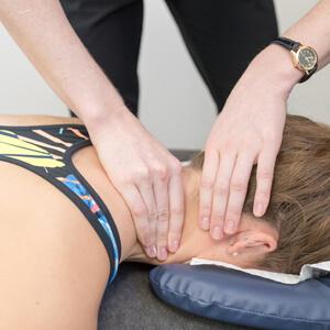 Neck treatment on client