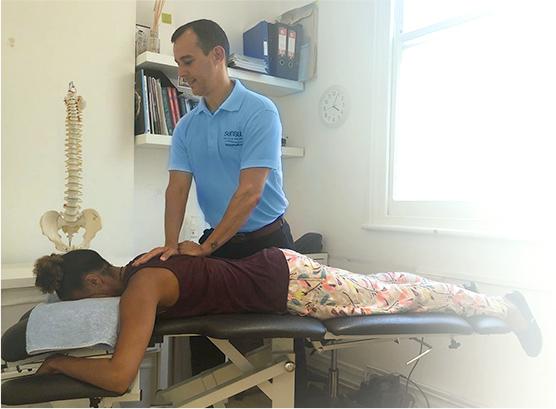 Dr Kris adjusting patient