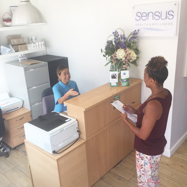 Front desk greeting new patient