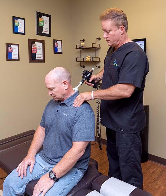 Dr. Pray adjusting patient