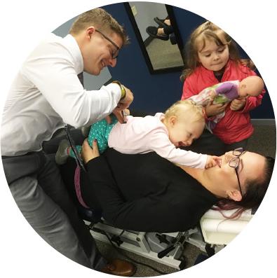 Dr. Stuttgen adjsuting baby on mom