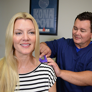 Dr. Hogan performing SASTM treatment