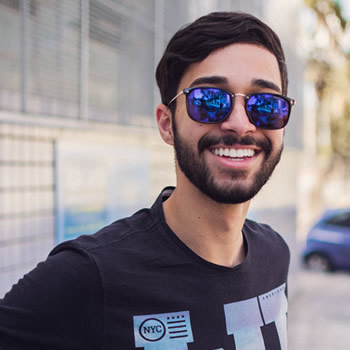 Man on shades smiling white teeth