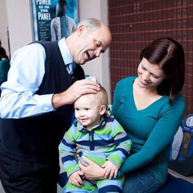 Dr. Thoma adjusting child