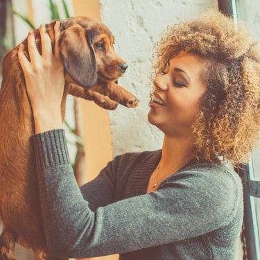 woman-holding-puppy
