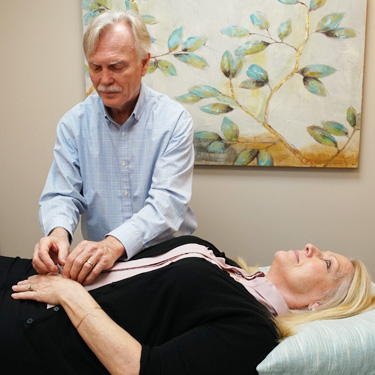 Dr. Joe applying acupuncture on patient