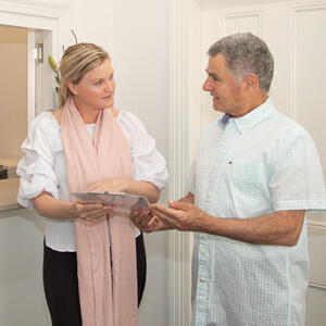 Receptionist talking with patient