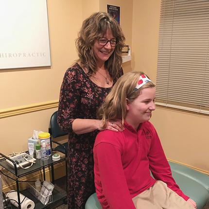 Dr. Tamara Blossic adjusting a patient