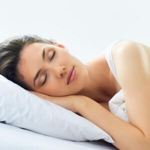 Woman with dark hair, sleeping