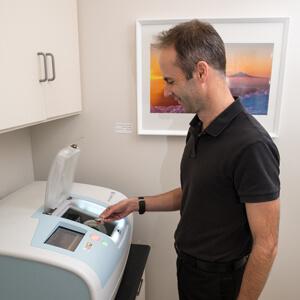 Dr Gray loading CAD machine
