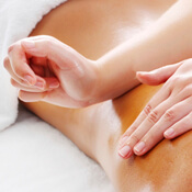 Massage therapist working on patient's lower back