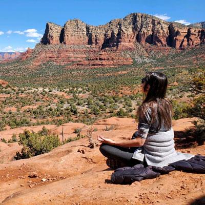 Woman meditating in desert