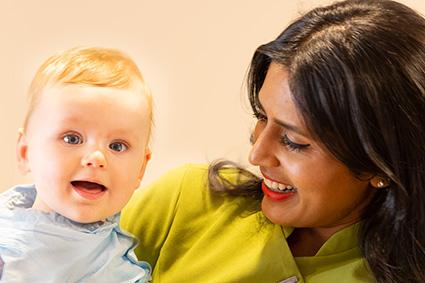 Dr Mahadevan with toddler