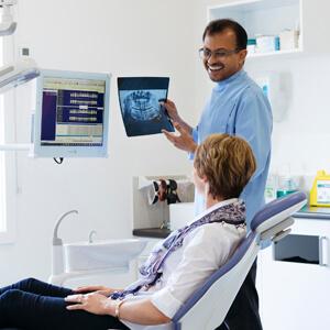 Dr Sav explaining xray to patient