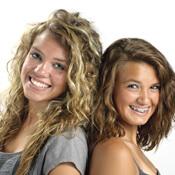 Two teenage girls, one wearing metal braces