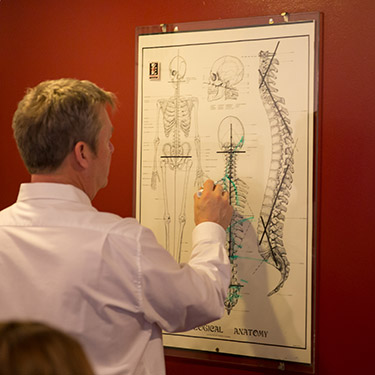 Dr. Cole looking at spine board