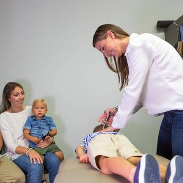Dr Ivana adjusting boy