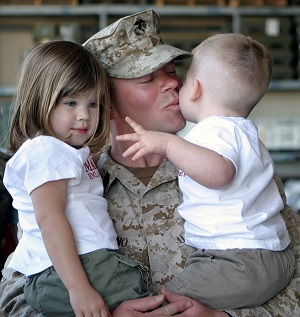 soldier hugging kids